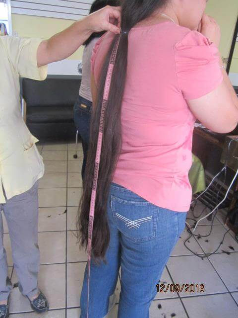 I'm selling virgin brown (chestnut) straight hair 28 inches long